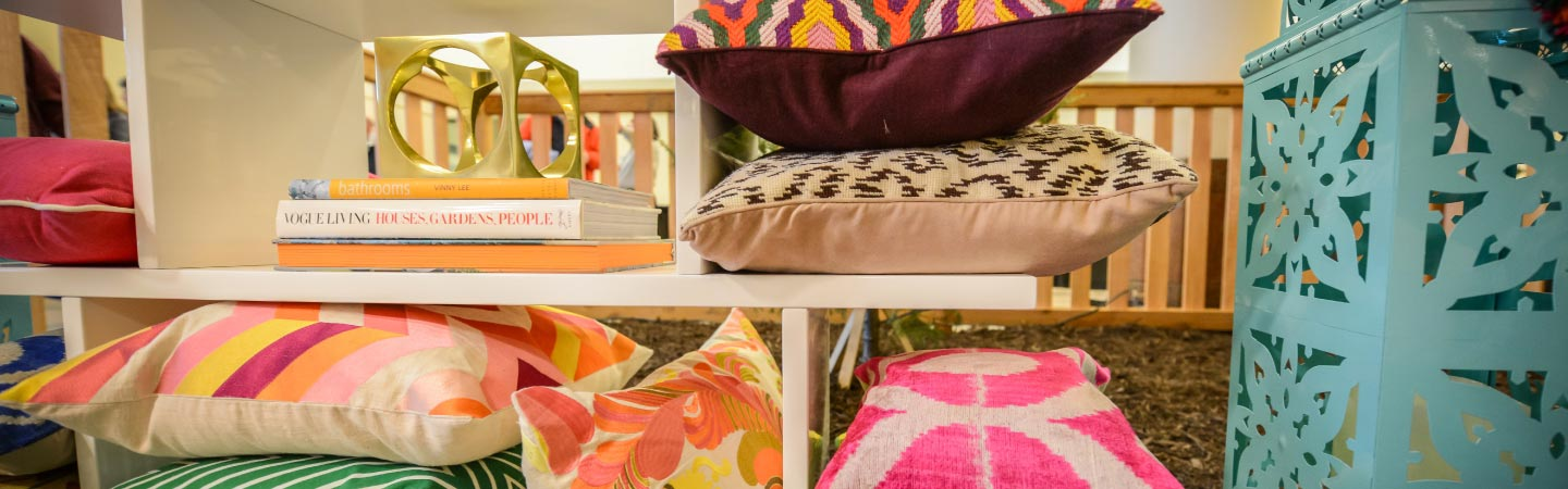 Shelf with colorful cushions